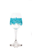 Blue ice in wine glass. Isolated on white background Royalty Free Stock Photography