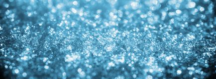 Blue ice winter art bokeh. Frozen christmas abstract background royalty free stock photo