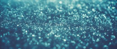 Blue ice winter art bokeh. Frozen christmas abstract background stock photography
