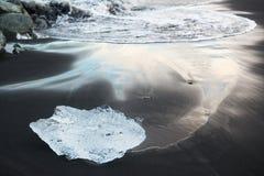 Blue iceberg on the black sand beach, Jokulsarlon lagoon, Iceland Stock Photography
