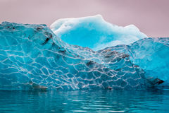 Blue iceberg in cold lake in Iceland Royalty Free Stock Image