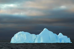 Blue iceberg with dark sky Stock Image