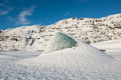 Blue iceberg on a frozen glacial lake at Skaftafellsjokull glacier at winter, Iceland Royalty Free Stock Photo