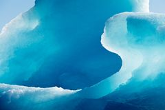 Shiny blue ice texture of glacial iceberg Royalty Free Stock Photography