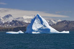 Blue iceberg with land Royalty Free Stock Photography