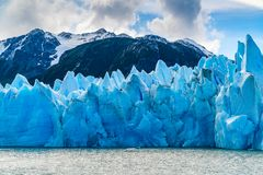 Blue Iceberg Of Gracier Grey With The Beautiful Mountain And Lake Grey Royalty Free Stock Photo