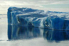 Blue iceberg with reflection. Blue iceberg with water reflection Stock Images