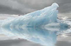 Blue iceberg reflection Stock Photography