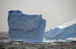 Blue iceberg in storm. Blue broken iceberg in Antarctic storm Stock Photography