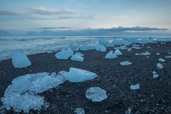 Blue icebergs on the beach Royalty Free Stock Image