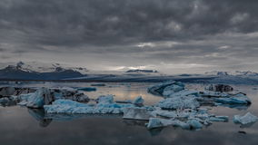 Blue icebergs floating under midnight sun time-lapse. Midnight sun Time lapse of blue icebergs floating in Jokulsarlon glacial lagoon, Iceland in 4K stock footage
