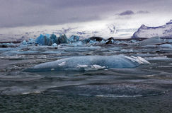 Blue Icebergs of Jokulsarlon with Snaefell Mountain, Iceland Stock Images
