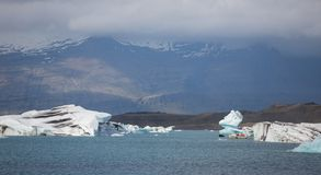 Blue icebergs, lagoon and tourist boat Stock Image
