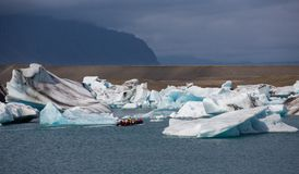 Blue icebergs, lagoon and tourist boat Royalty Free Stock Photography