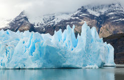 Blue icebergs and snowy mountains Stock Photo