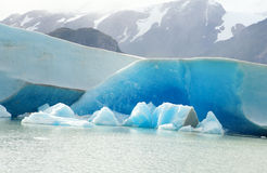 Blue icebergs and snowy mountains Stock Image