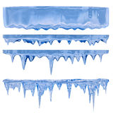 Blue icicles. Thawing icicles of a blue shade with water droplets stock photos