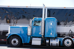 Blue icon American custom big rig semi truck profile. Beautiful classic blue big rig semi truck - a real American style icon among fans and drivers of heavy stock image