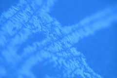 Blue icy background. Macro abstract of ice crystals forming on the body of a car Royalty Free Stock Photos