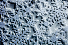 Blue icy background with snowflakes Royalty Free Stock Photos