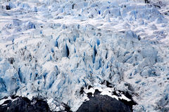 Blue Icy Portage Glacier Rock and Crevasses Alaska Stock Photo