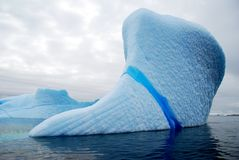 Blue icy streak in an iceberg Stock Images