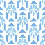 Blue ikat seamless vector pattern. Textile fabric Stock Images
