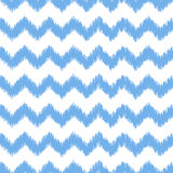 Blue ikat seamless vector pattern. Textile fabric Stock Photos