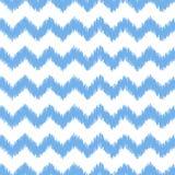 Blue ikat seamless vector pattern. Textile fabric Stock Photos