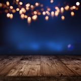 Blue illuminated backdrop with golden bokeh. For a festive decoration Royalty Free Stock Photos