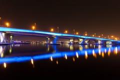 Blue illuminated Bridge in Dubai Stock Images