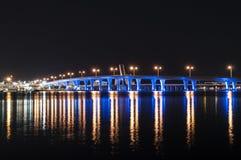 Blue illuminated bridge in Miami Stock Images