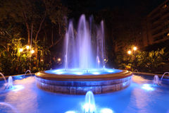 Blue illuminated fountain Stock Photos