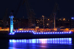 Blue illuminated industry at night Stock Photo