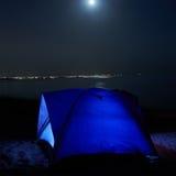 Blue illuminated tent at night Stock Photography