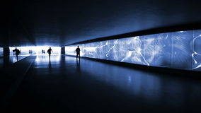 Blue illuminated underpass / subway - people walking by stock footage