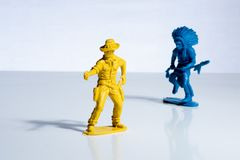 Blue indian and yellow cowboy plastic toy figures stock photography