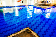 Blue indoor swimming pool Royalty Free Stock Photo