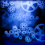 Cogs Gears Industrial Background. A montage of connected industrial cogs or gears with a blue tone and metallic texture Stock Image