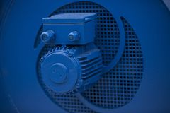 Blue industrial electric motor. Inside of industrial area royalty free stock photos