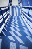 Blue industrial metal staircase perspective Stock Photo