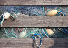Blue industry fishing nets in old wooden storage box Stock Image