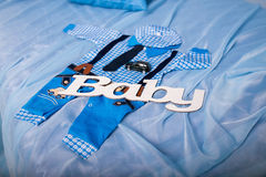 Blue infant boy clothing  with word baby and toy car for baby shower Royalty Free Stock Image