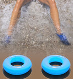 A blue inflatable donut on the seashore Stock Photography