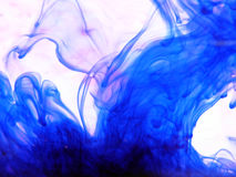 Blue Ink. In water stock images