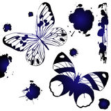 Blue ink butterflies. Decorative ink butterflies against white background, grunge art Stock Photo