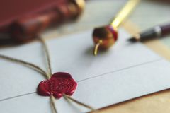 Blue ink, feather, glasses and red sealing wax. Blue ink, feather, glasses and red sealing royalty free stock photos