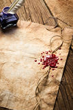 Blue ink, feather, glasses and red sealing wax. On old wooden table Stock Photo