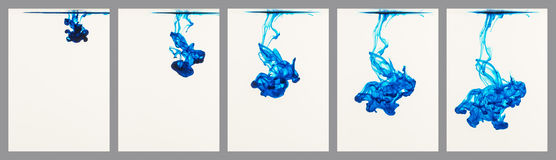 Blue ink flowing through water Stock Photography