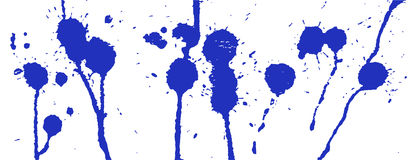 Blue ink splash. Paint splatter. Blue blots on white. Ink stains Royalty Free Stock Image